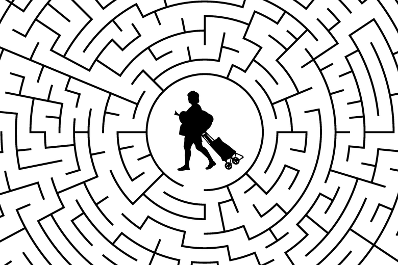 A silhouette of a woman carrying groceries and pulling a wheel cart stuck in the middle of a maze.