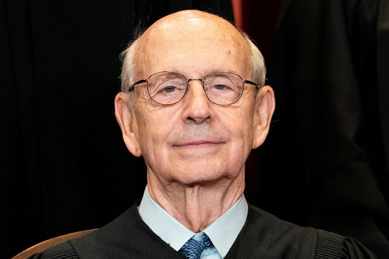 Breyer in his robes smiling for a photo
