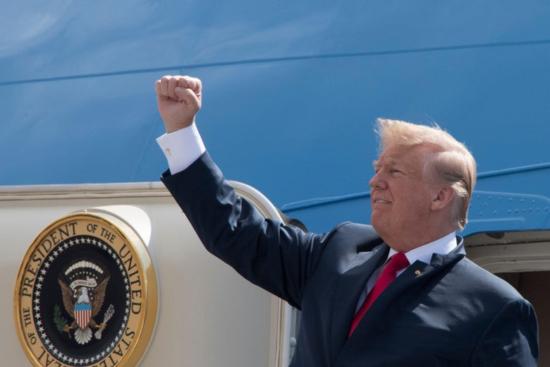 Donald Trump pumps his fist while exiting Air Force 1.