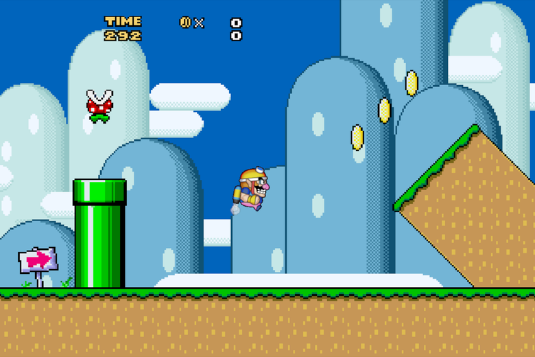 A little blue-and-yellow man flies in the air across a screen with blue skies, hills, and a green pipe behind him. In front of him are three yellow coins and a leaning green-and-brown tower.