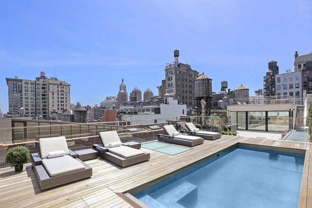 A large private rooftop pool