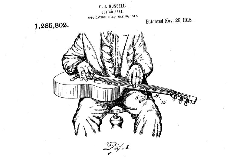 A drawing of a man playing a guitar, in a boring fashion.