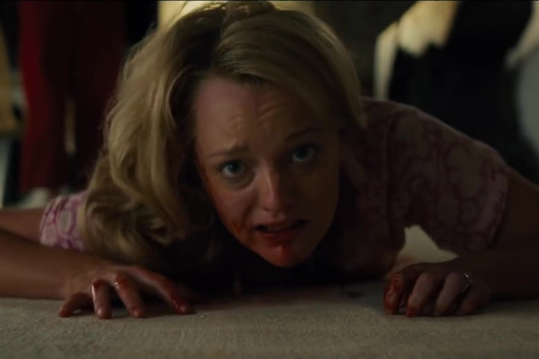 Elisabeth Moss, covered in blood, crawls across a white carpeted floor.