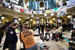 A small number of protestors continue to demonstrate in the capitol building in Madison, Wisconsin. Click image to expand.