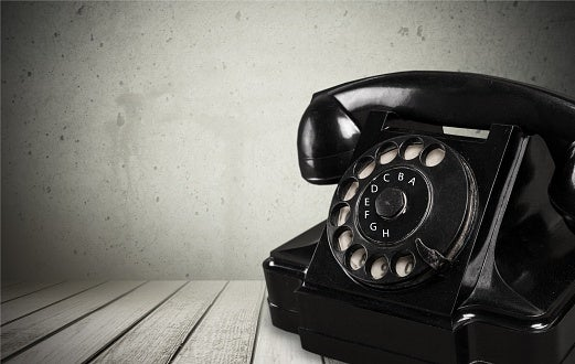 Photo of a rotary phone in black and white.