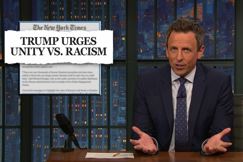 "Seth Meyers gestures in disbelief in front of a New York Times headline reading ""TRUMP URGES UNITY VS. RACISM."""