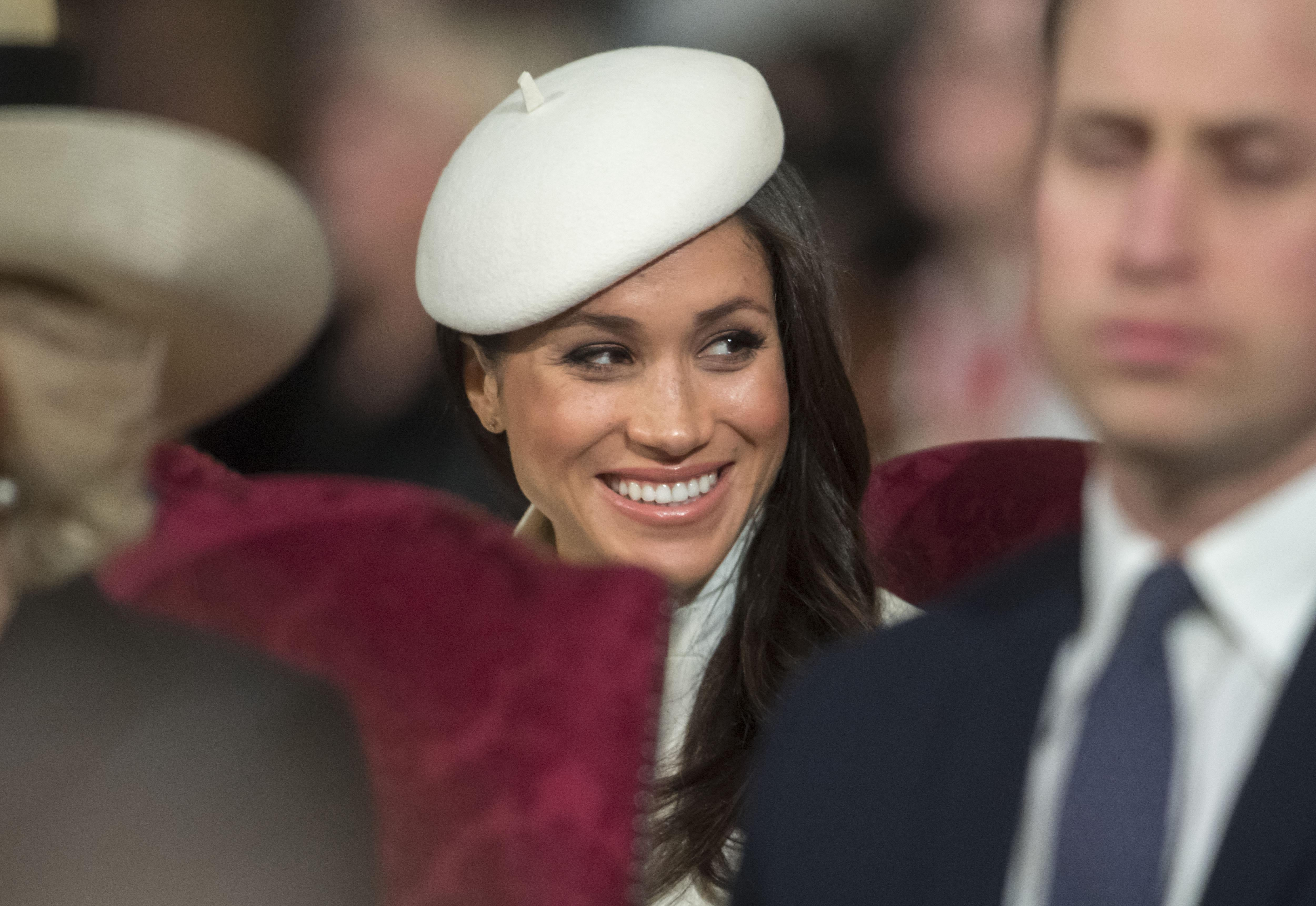 LONDON, UNITED KINGDOM - MARCH 12: Meghan Markle smiles as she shares a joke with Prince Andrew during the Commonwealth Service at Westminster Abbey on March 12, 2018 in London, England. Organised by The Royal Commonwealth Society, the Commonwealth Service is the largest annual inter-faith gathering in the United Kingdom. (Photo by Paul Grover - Pool/Getty Images)