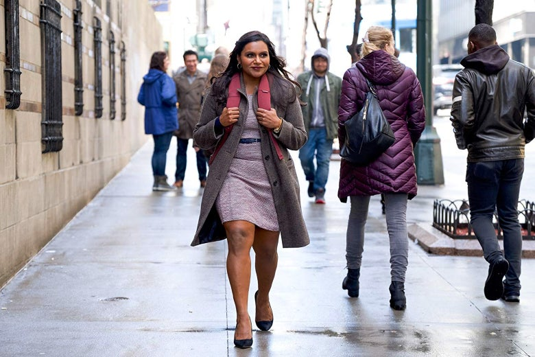 Kaling as Molly Patel, walking down a city street wearing a backpack and smiling excitedly.