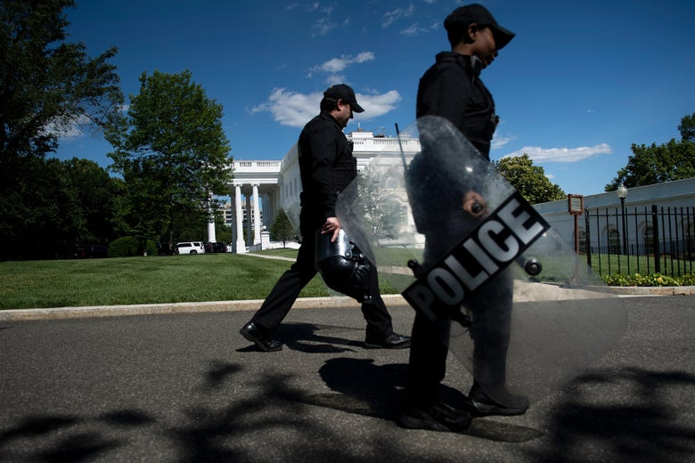 Members of the Secret Service walk past the White House as protests over the death of George Floyd continue on June 1, 2020, in Washington, D.C.