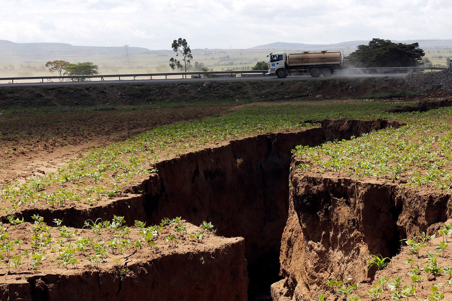 A tanker drives near a chasm suspected to have been caused by a heavy downpour along an underground fault line near the Rift Valley town of Mai-Mahiu, Kenya on 28, 2018.