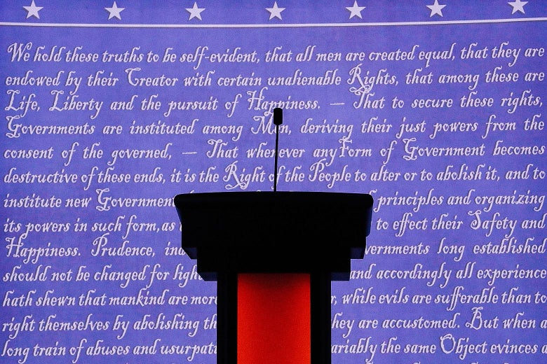 Empty podium in front of a blue screen with the Constitution written in white.