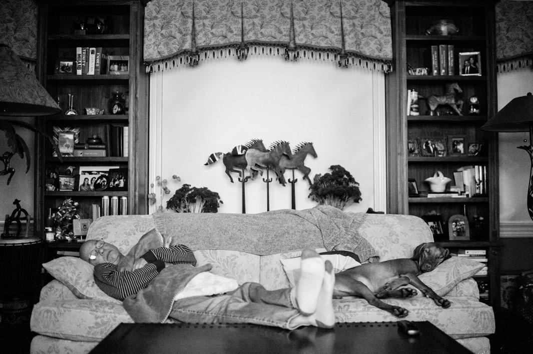 Treatment leaves Howie Borowick exhausted most days, and he can be found napping in various rooms around his house, like the living room, along side his grand-puppy Nova, an eight-month old Vizsla. Chappaqua, New York. February, 2013.