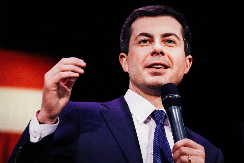 Pete Buttigieg holding a mic and speaking with an American flag in the background