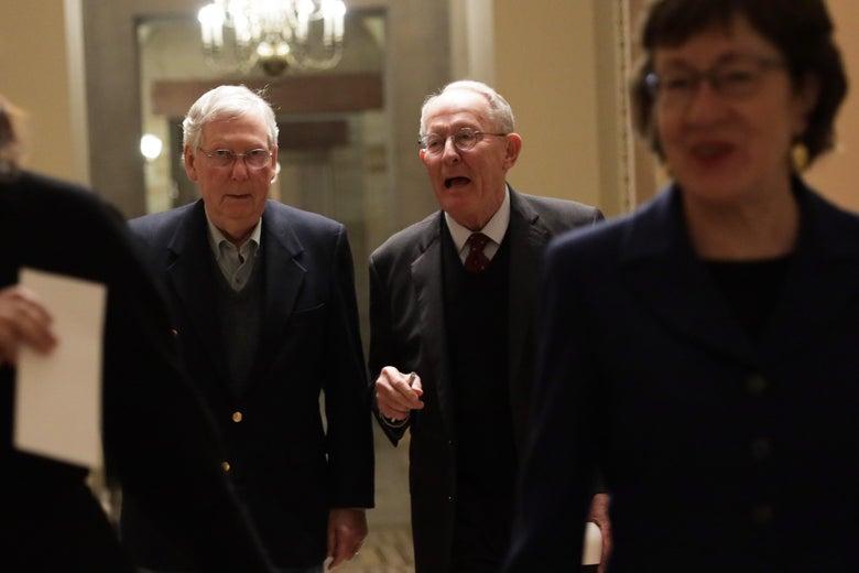 U.S. Senate Majority Leader Sen. Mitch McConnell walks with Sen. Lamar Alexander and Sen. Susan Collins in a hallway after a vote December 2, 2019 at the U.S. Capitol in Washington, DC.