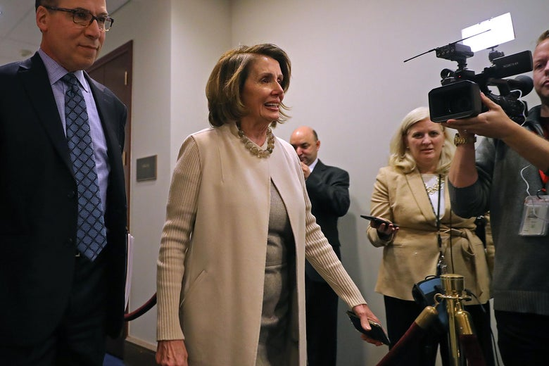 House Democratic Leader Nancy Pelosi walks into a Democratic caucus meeting.