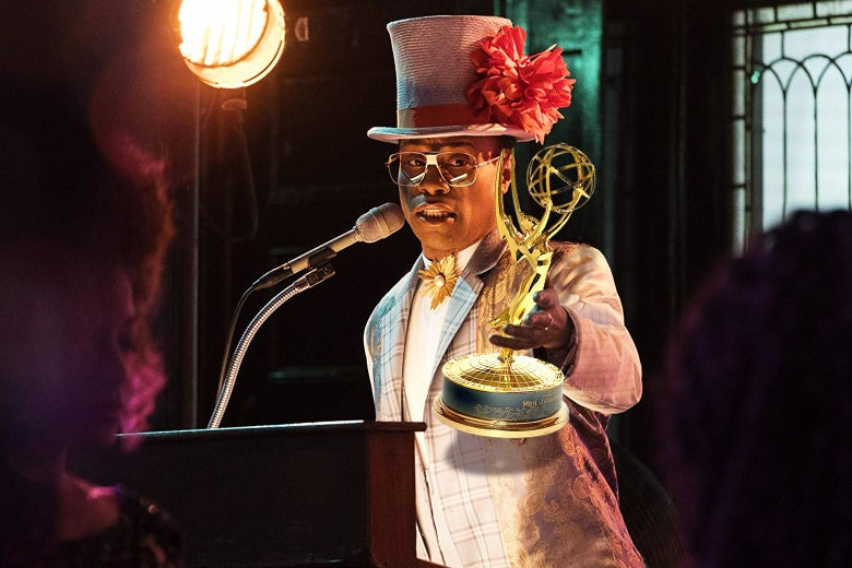 Billy Porter in Pose holding an Emmy.