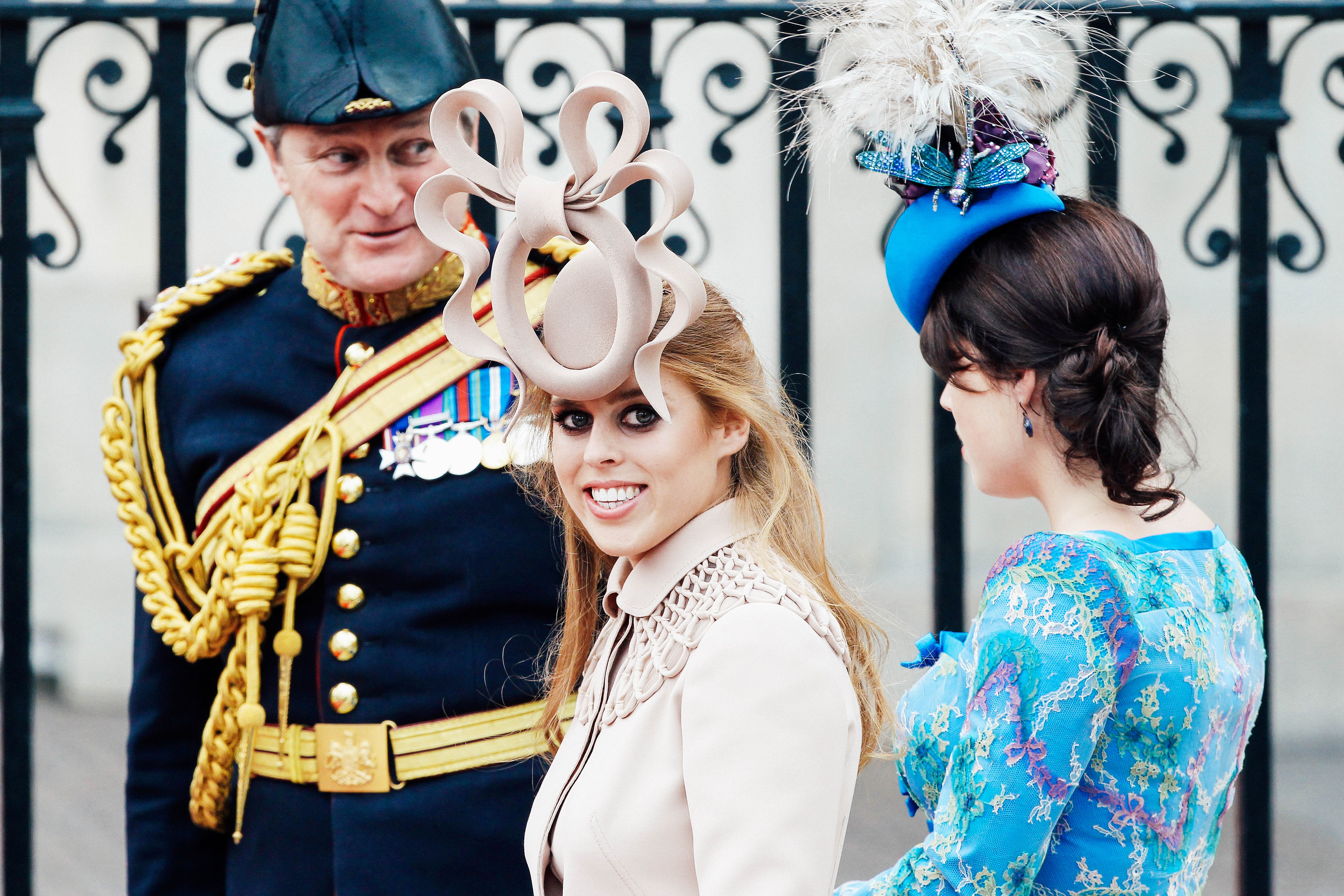 Princess Beatrice of York sports an elaborate pale-pink fascinator.