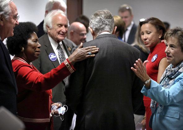 Senate Majority Leader Sen. Harry Reid (D-NV) (C) arrives at a ceremony as he is welcomed by (L-R) Sen. Tom Harkin (D-IA), Rep. Sheila Jackson-Lee (D-TX), Rep. Sander Levin (D-MI), Rep. Nydia Velazquez (D-NY), and Rep. Jan Schakowsky (D-IL) October 1, 2013 on Capitol Hill in Washington, DC.