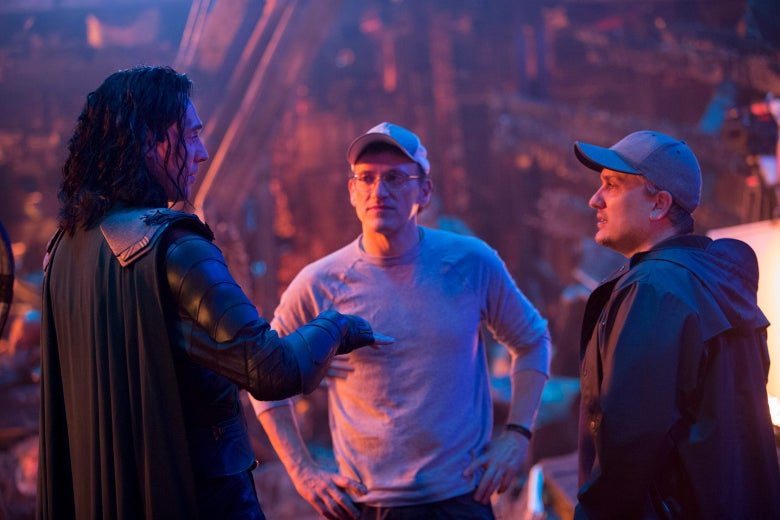 Joe and Anthony Russo directing Hiddleston as Loki on set.