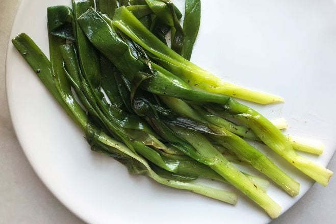 Cooked scallions on a plate.