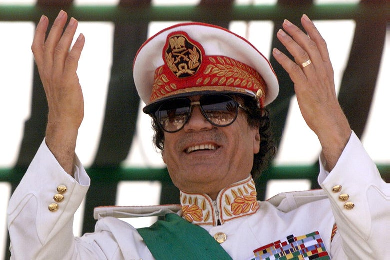 TRIPOLI, LIBYA:  Libyan leader Moamer Kadhafi salutes his troops participating 07 September 1999 in a military parade in Tripoli to mark the 30th anniversary of the Libyan Revolution that brought Kadhafi to power. Troops from 24 African states joined the flamboyant, five-hour parade which also heralds this week's extraordinary summit of the Organisation of African Unity (OAU). (Photo credit should read MARWAN NAAMANI/AFP/Getty Images)