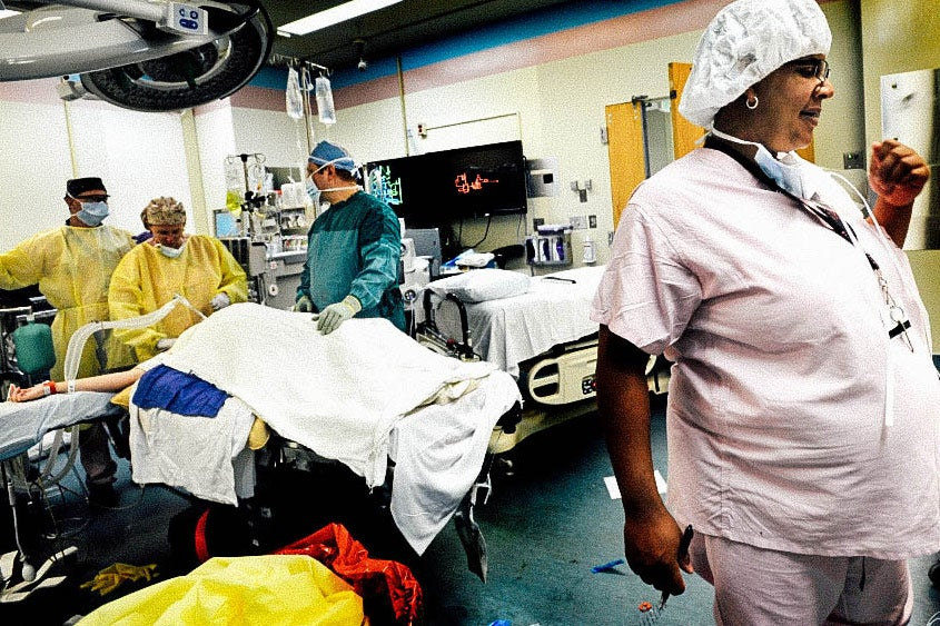 Laurie in scrubs in an operating room.