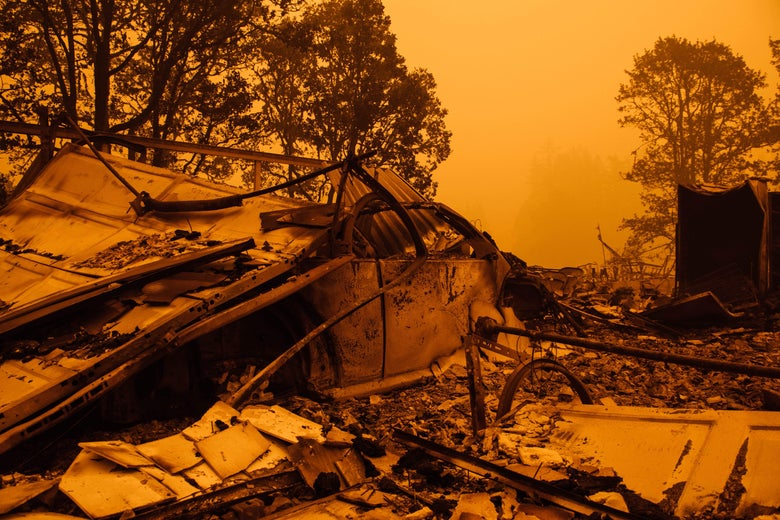 An orange, smoke-filled sky and burnt remains