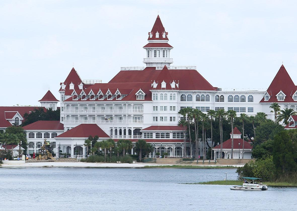 A boat belonging to the Orange County Sheriff's office searches the Seven Seas lagoon outside Disney's Grand Floridian Resort & Spa near Orlando, Florida on June 15, 2016.