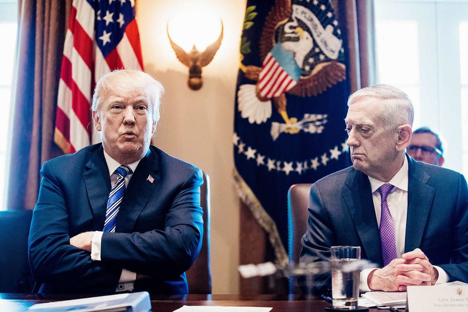 President Donald J. Trump speaks beside  Secretary of Defense Jim Mattis during a meeting with Cabinet members on March 8 in Washington.