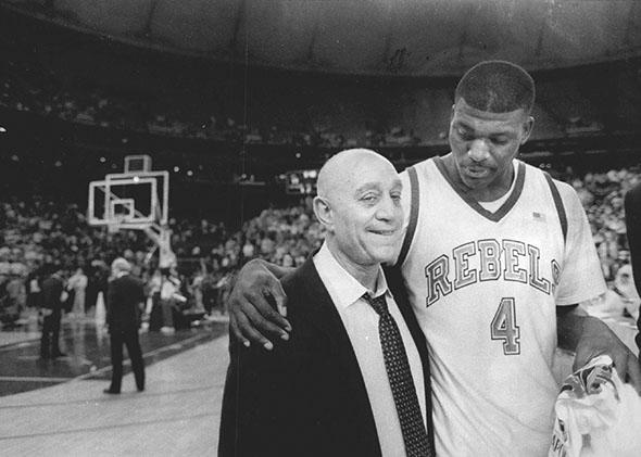 Larry Johnson and coach Jerry Tarkanian leave the court headed to the Final Four again.