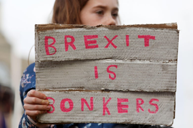 A protester holds a sign as she attends a march and rally organized by the pro-European People's Vote campaign for a second EU referendum in central London on March 23, 2019.