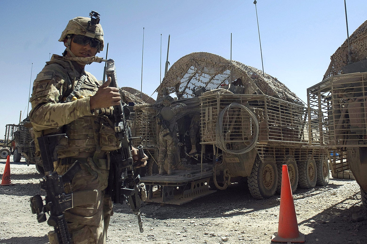 A soldier attached to the 2nd platoon, C-Coy. 1-23 infantry based at Zangabad forward operating base in Panjwai District, Afghanistan, gestures on Sept. 22, 2012.