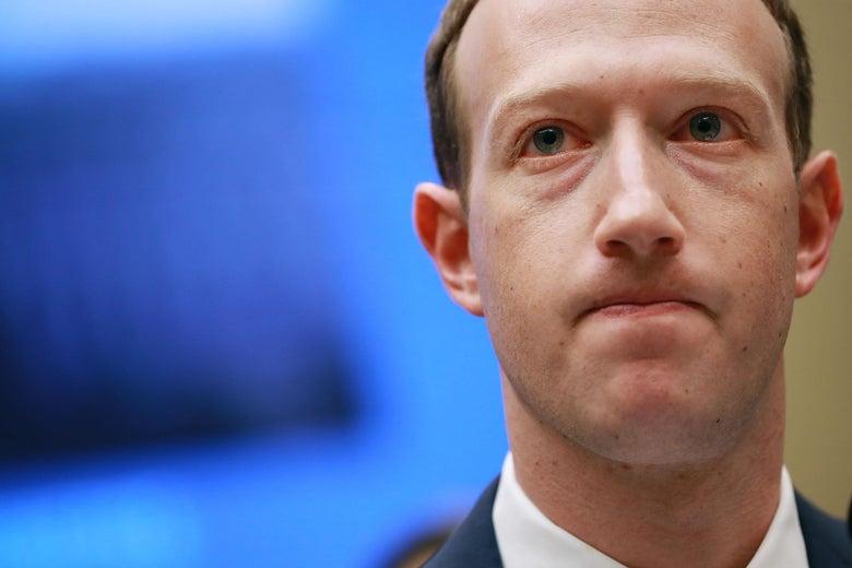 Mark Zuckerberg purses his lips.