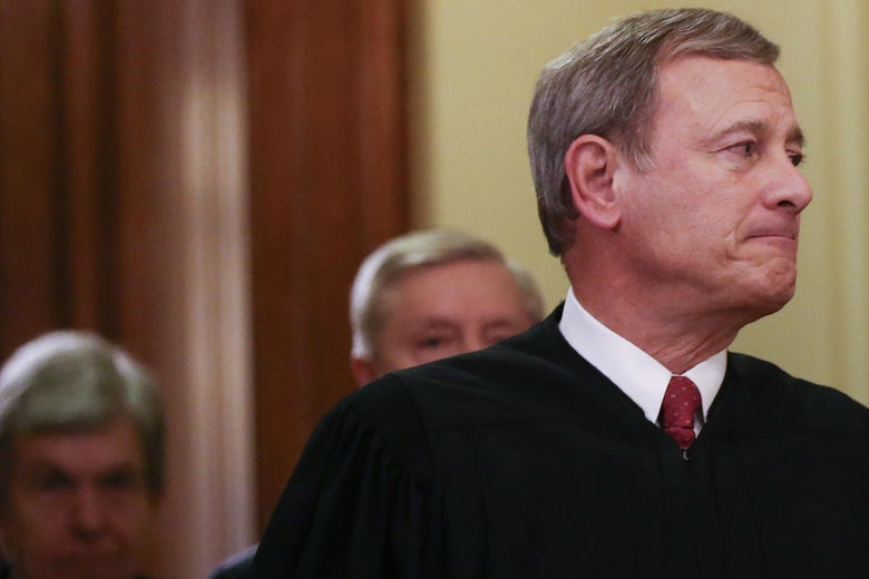 John Roberts bites his lip as he departs the Senate chamber along with Sen. Lindsey Graham (R-SC) (C) and Sen. Roy Blunt (R-MO) after the Senate impeachment trial of U.S. President Donald Trump concluded on February 5, 2020 in Washington, DC. The Senate voted to acquit President Donald Trump in the impeachment trial.