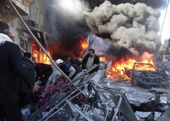 Medical personnel look for survivors following a reported airstrike on the Tariq al-Bab district of the northern Syrian city of Aleppo on February 1, 2014.