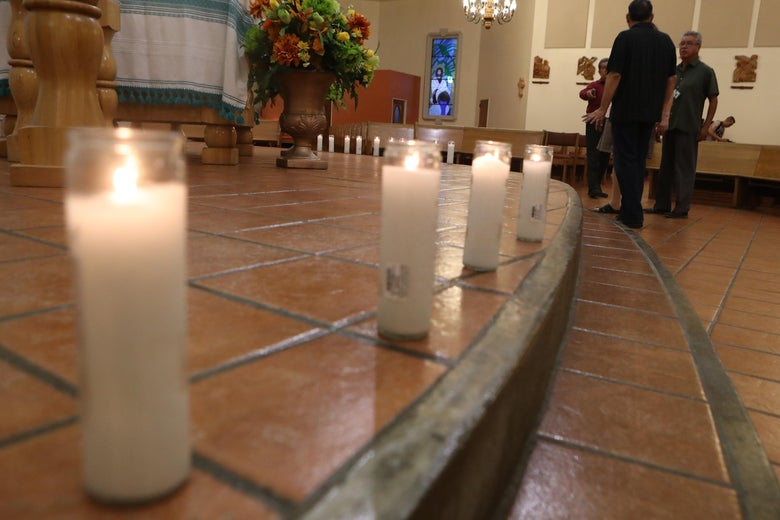 A row of candles on the floor of the church.