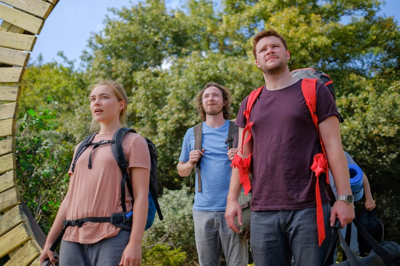 A still from the movie Midsommar with four actors in front of trees.