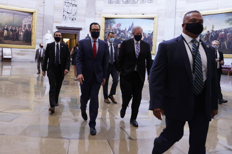 Mnuchin and Meadows walk through the Capitol.
