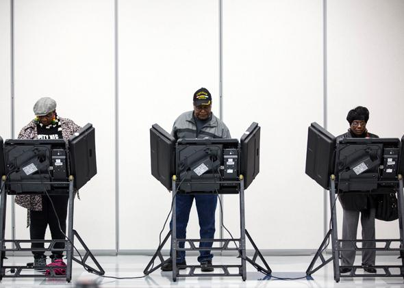 Voters cast their ballots in the midterm elections in Ferguson, Missouri, on Nov. 4, 2014