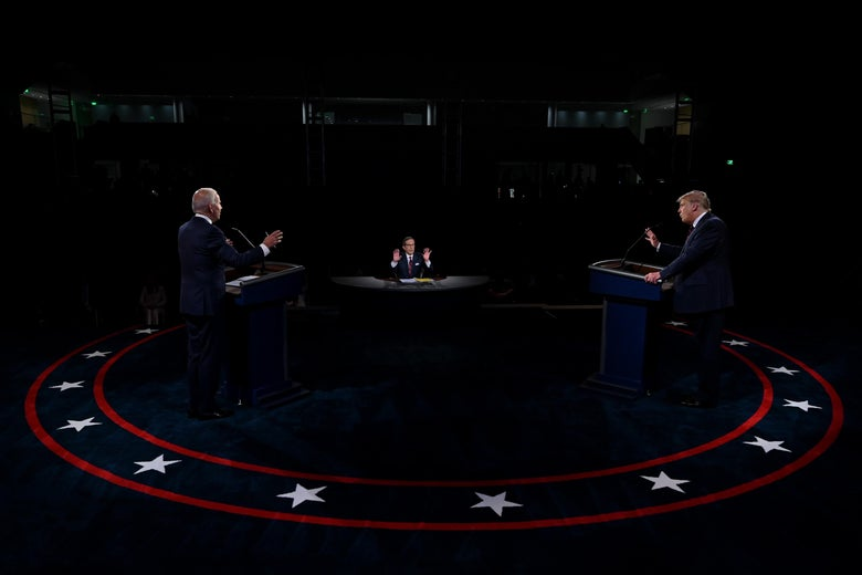 Trump and Biden stand behind podiums during the first presidential debate.