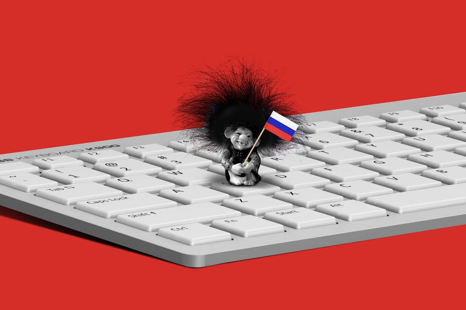 A Troll doll holding a Russian flag while standing on a keyboard.
