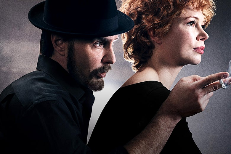 A hat-clad Sam Rockwell, as Bob Fosse, leans over Michelle Williams, as Gwen Verdon, gesturing off-camera over her shoulder with a hand holding a lit cigarette.