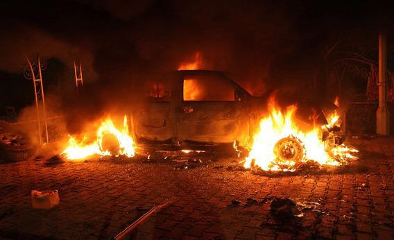 A vehicle and the surrounding area are engulfed in flames after being set on fire inside the U.S. consulate compound in Benghazi late on Sept. 11, 2012