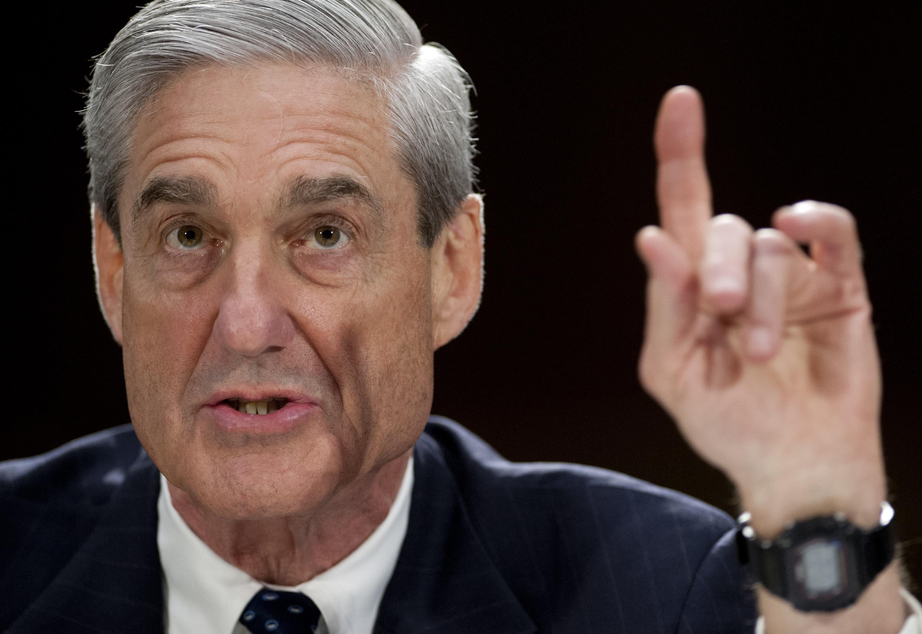 Special Counsel Robert Mueller speaking while making a pointed hand gesture.