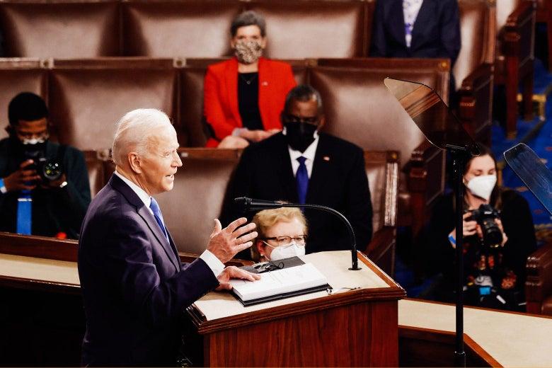 Joe Biden, in profile, as he speaks from a podium in Congress.