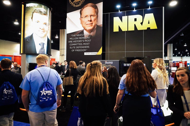 National Rifle Association CEO Wayne LaPierre's image floats above the NRA booth during the first day of the Conservative Political Action Conference at the Gaylord National Resort and Convention Center on Feb. 23 in National Harbor, Maryland.